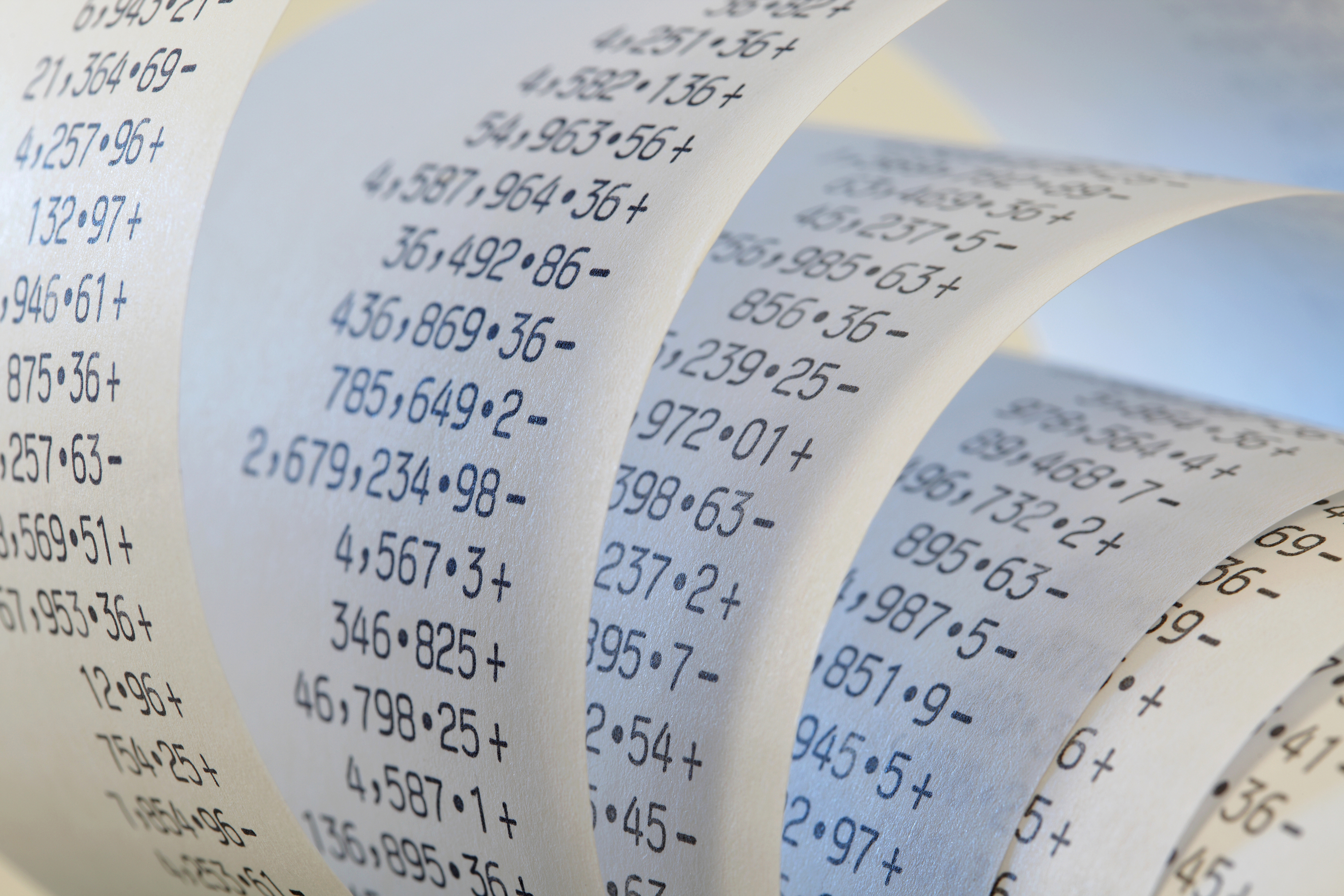 Printing Calculator paper tape rolled up, in blue light